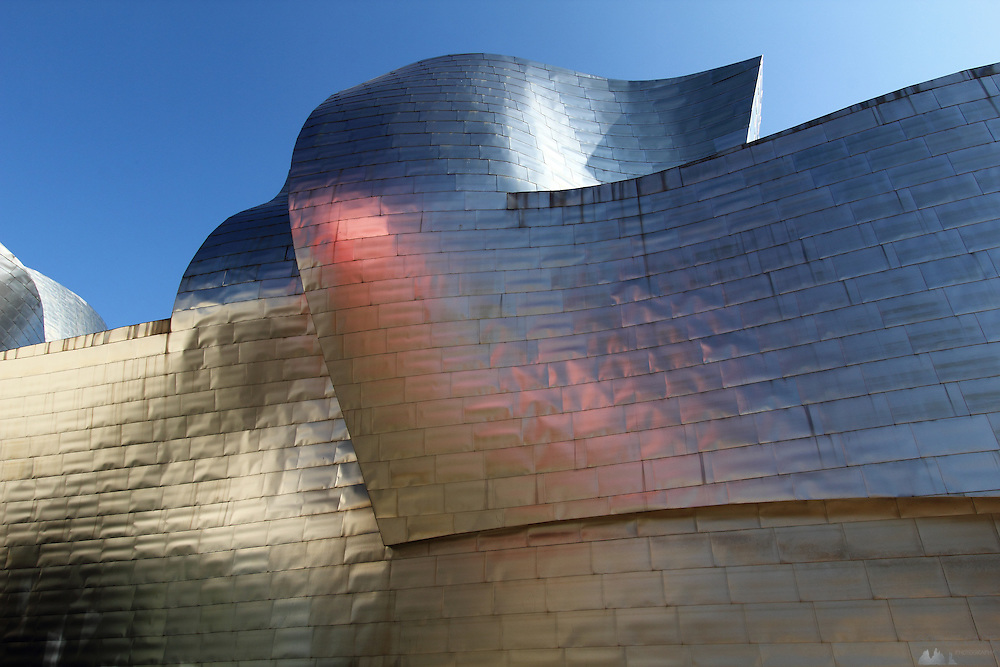 Coloured reflections in the titanium body of the Guggenheim museum in Bilbao