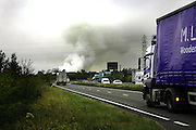 View from the A14 looking west close to a farm fire near Burton Latimer