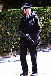 © licensed to London News Pictures. LONDON, UK  02/05/2011. A armed Met Police officer patrols in front of the US Embassy in Grosvenor Square the day after the US Government announces that Osama Bin Laden has been killed in Pakistan. Security in London expected to be increased in the coming weeks in anticipation of a reprisal attack. Please see special instructions for usage rates. Photo credit should read CLIFF HIDE/LNP