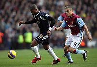Photo: Rich Eaton.<br /> <br /> Aston Villa v West Ham. The Barclays Premiership. 03/02/2007. Marlon Harewood left of West Ham left tries to get past Villas Wilfred Bouma