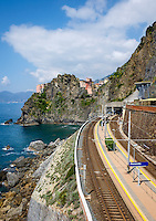 MANAROLA, ITALY - CIRCA MAY 2015:  View of train station and sea cliffs  in the village of Manarola in Cinque Terre, Italy.