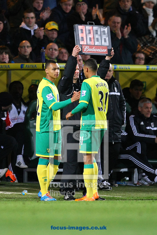 Picture by Paul Chesterton/Focus Images Ltd +44 7904 640267<br /> 04/01/2014<br /> Jacob Murphy of Norwich prepares to make his debut as a substitute replacing his twin brother Josh Murphy of Norwich during The FA Cup match at Carrow Road, Norwich.