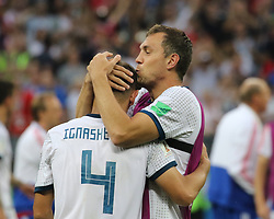 July 1, 2018 - Moscow, Russia - July 01, 2018, Russia, Moscow, FIFA World Cup 2018, the playoff round. Football match Spain - Russia at the stadium Luzhniki. Player of the national team Artem Dzyuba; Artem Dzyuba; Sergey Ignashevich. (Credit Image: © Russian Look via ZUMA Wire)