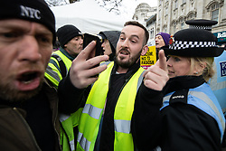 "© Licensed to London News Pictures . 09/02/2019. Manchester , UK . JAMES GODDARD live streams video using his mobile phone as he leads a "" Yellow Vest "" protest in Manchester City Centre . The yellow vest concept has been adopted from French demonstrators by some British groups in support of Brexit , Donald Trump and former EDL leader Stephen Yaxley-Lennon - aka Tommy Robinson . A similar demonstration in the city in January was ridiculed after protesters were kettled by police in front of a branch of Greggs the Baker . Photo credit : Joel Goodman/LNP"
