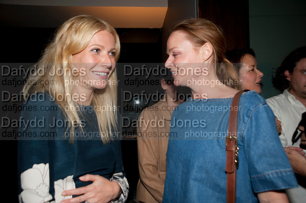 GWYNETH PALTROW; STELLA MCCARTNEY, A Living man declared Dead and Other Chapters. Taryn Simon. Tate Modern, London. 24 May 2011. <br /> <br />  , -DO NOT ARCHIVE-&copy; Copyright Photograph by Dafydd Jones. 248 Clapham Rd. London SW9 0PZ. Tel 0207 820 0771. www.dafjones.com.