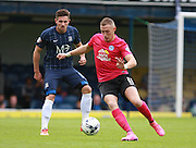 Peterborough United player Marcus Maddison shields the ball from Southend player Ryan Leonard during the Sky Bet League 1 match between Southend United and Peterborough United at Roots Hall, Southend, England on 5 September 2015. Photo by Bennett Dean.