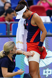 WUHAN, Sept. 28, 2018  Wang Qiang (R) of China receives medical treatment during the singles semifinal match against Anett Kontaveit of Estonia at the 2018 WTA Wuhan Open tennis tournament in Wuhan, central China's Hubei Province, on Sept. 28, 2018. Anett Kontaveit advanced to the final after Wang Qiang withdrew due to injury. (Credit Image: © Song Zhenping/Xinhua via ZUMA Wire)
