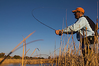 FLY ANGLER FISHING IN THE PEASE RIVER IN TEXAS