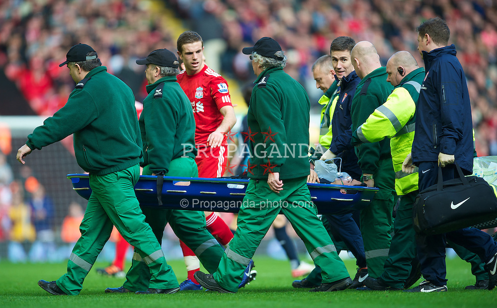 LIVERPOOL, ENGLAND - Saturday, March 3, 2012: Arsenal's Mikel Arteta is taken off injured on a stretcher during the Premiership match against Liverpool at Anfield. (Pic by David Rawcliffe/Propaganda)