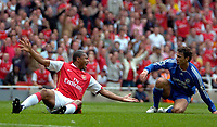 Photo: Ed Godden/Sportsbeat Images.<br /> Arsenal v Chelsea. The Barclays Premiership. 06/05/2007.<br /> Arsenal's Julio Baptista (L), is brought down in the area by Chelsea's Khalid Boulahrouz, resulting in a penalty.