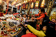 Lion dancers perform at the Thien Hau temple to celebrate the first day of the Chinese Lunar New Year, the Year of the Dog, on Thursday February 16, 2018, in Los Angeles.. (Xinhua/Zhao Hanrong)<br /> 2月16日,农历正月初一凌晨,在美国洛杉矶,大批华人涌入中国城天后宫庙上香祈福。图为民众在庙內舞狮。新华社发 (赵汉荣摄) (Photo by Ringo Chiu)<br /> <br /> Usage Notes: This content is intended for editorial use only. For other uses, additional clearances may be required.