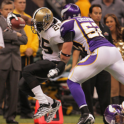 2008 October, 06: New Orleans Saints running back Reggie Bush (25) is forced out of bounds by Minnesota Vikings linebacker Chad Greenway (52)during the first half of a week five regular season game between the Minnesota Vikings and the New Orleans Saints for Monday Night Football at the Louisiana Superdome in New Orleans, LA.