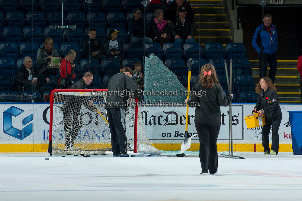 KELOWNA, CANADA - NOVEMBER 9: Prospera ice crew cleans up broken glass after a warm up shot from Riley Stadel #3 of the Kelowna Rockets shattered the pane on November 9, 2013 at Prospera Place in Kelowna, British Columbia, Canada.   (Photo by Marissa Baecker/Shoot the Breeze)  ***  Local Caption  *** Riley Stadel;