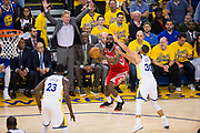 Houston Rockets guard James Harden (13) shoots a three pointer against the Golden State Warriors during Game 3 of the Western Conference Finals at Oracle Arena in Oakland, Calif., on May 20, 2018. (Stan Olszewski/Special to S.F. Examiner)