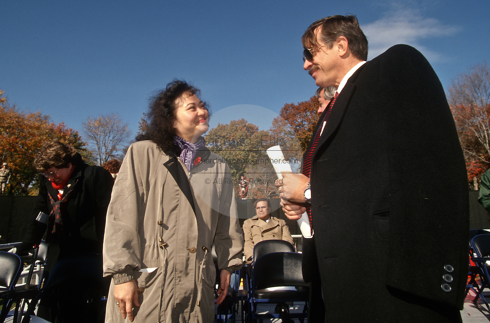 Phan Thi Kim Phuc, a napalm victim pictured in a Pulitzer Prize-winning 1972 photo by Nick Ut with Jan Scruggs, founder of the Vietnam Veterans Memorial sduring a Veterans Day ceremony at the Vietnam Veterans Memorial November 11, 1996 in Washington, DC.