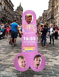 Edinburgh, Scotland, UK; 5 August, 2018. Edinburgh Fringe Festival's first weekend sees thousands of tourists and locals on the Royal Mile  enjoying the free street performers. Pictured; Man advertising his play Pity Laughs - A Tale of Two Gays.
