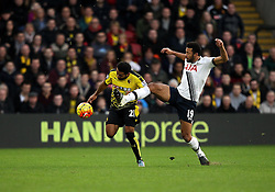 Ikechi Anya of Watford heads the ball on as Mousa Dembele of Tottenham Hotspur tries to tackle him - Mandatory byline: Robbie Stephenson/JMP - 07966 386802 - 28/12/2015 - FOOTBALL - Vicarage Road - Watford, England - Watford v Tottenham Hotspur - Barclays Premier League