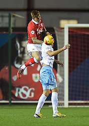 Bristol City's Aden Flint heads the ball past Coventry City's Gary Madine - Photo mandatory by-line: Paul Knight/JMP - Mobile: 07966 386802 - 10/12/2014 - SPORT - Football - Bristol - Ashton Gate Stadium - Bristol City v Coventry City - Johnstone's Paint Trophy