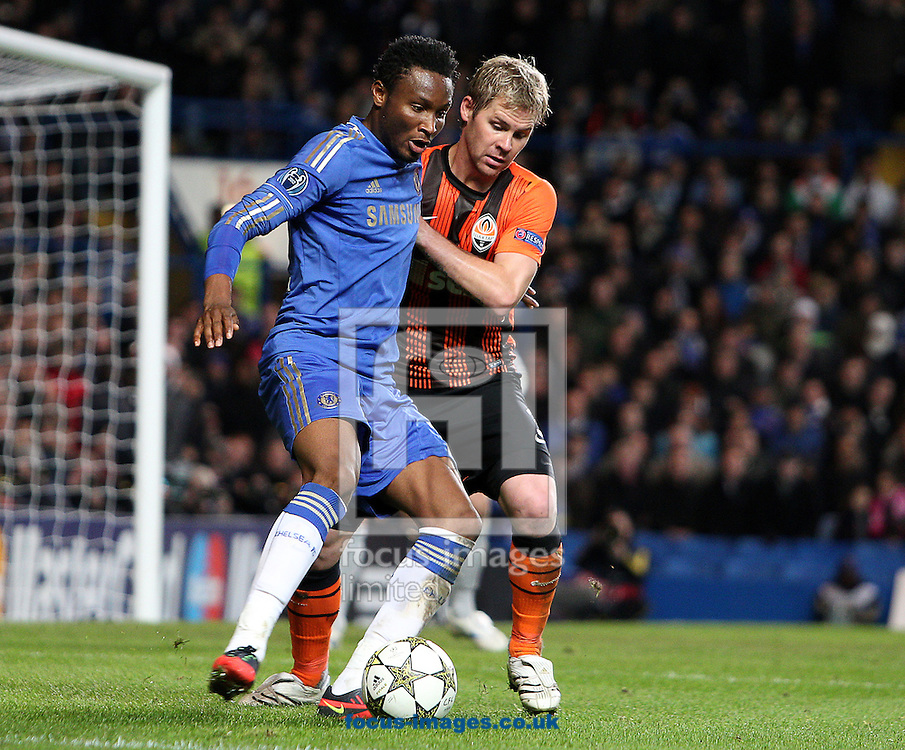Picture by Paul Terry/Focus Images Ltd +44 7545 642257.07/11/2012.John Obi Mikel of Chelsea and Tomas Hubschman of Shakhtar Donetsk during the UEFA Champions League match at Stamford Bridge, London.