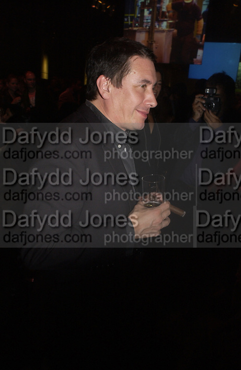 Jools Holland, Established and Sons UK Launch during Design Week. The Bus Depot, Hertford Road. Hoxton. 22 September 2005.  ONE TIME USE ONLY - DO NOT ARCHIVE © Copyright Photograph by Dafydd Jones 66 Stockwell Park Rd. London SW9 0DA Tel 020 7733 0108 www.dafjones.com
