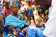 A woman waits for her child to be vaccinated in the village of Banankoro, Mali on Saturday August 28, 2010.