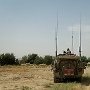 A Canadian Soldier stands watch beside his armored vehicle during a patrol in the Pashmul area of Zhari District, Kandahar Province, Afghanistan......