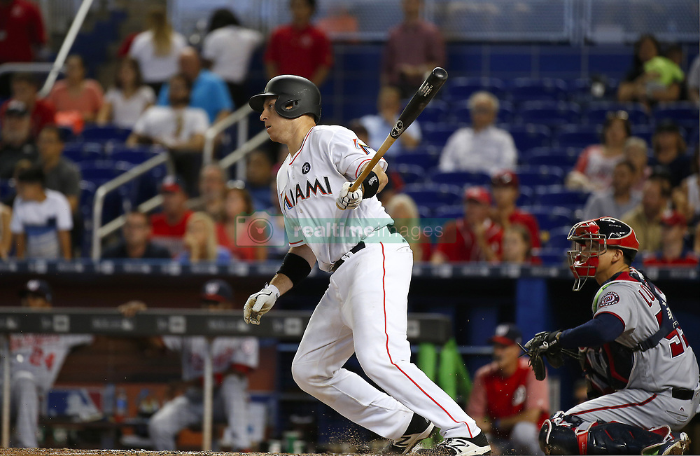 June 21, 2017 - Miami, FL, USA - Miami Marlins catcher A.J. Ellis hits a single during the eighth inning against the Washington Nationals on Wednesday, June 21, 2017 at Marlins Park in Miami, Fla. (Credit Image: © David Santiago/TNS via ZUMA Wire)