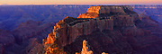 Sunrise lights the edge of Wotans Throne from Cape Royal on the North Rim of the Grand Canyon in Arizona