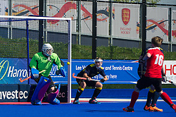 Team Bath Buccaneers' Tom Skinner saves a Holcombe penalty corner. Holcombe v Team Bath Buccaneers - Now: Pensions Finals Weekend, Lee Valley Hockey & Tennis Centre, London, UK on 12 April 2015. Photo: Simon Parker