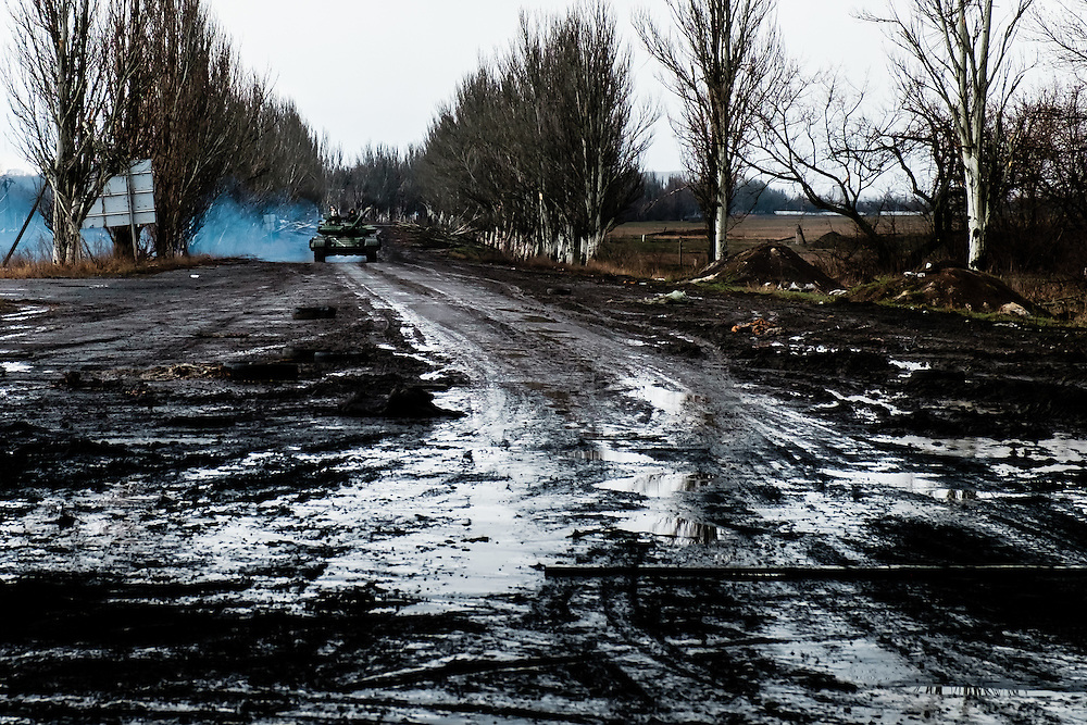 Ukrainian army tank coming back from the frontline because the separatists prepared an anti-tank operation according to the spied communications.