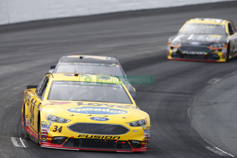 July 22, 2018 - Loudon, New Hampshire, United States of America - Michael McDowell (34) battles for position during the Foxwoods Resort Casino 301 at New Hampshire Motor Speedway in Loudon, New Hampshire. (Credit Image: © Justin R. Noe Asp Inc/ASP via ZUMA Wire)