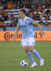 August 4, 2018 - Houston, TX, U.S. - HOUSTON, TX - AUGUST 04:  Sporting Kansas City defender Matt Besler (5) dribbles the ball during the soccer match between Sporting Kansas City and Houston Dynamo on August 4, 2018 at BBVA Compass Stadium in Houston, Texas.  (Photo by Leslie Plaza Johnson/Icon Sportswire) (Credit Image: © Leslie Plaza Johnson/Icon SMI via ZUMA Press)