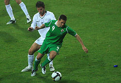 Bostjan Cesar (5) and David Healy at the fourth round qualification game of 2010 FIFA WORLD CUP SOUTH AFRICA in Group 3 between Slovenia and Northern Ireland at Stadion Ljudski vrt, on October 11, 2008, in Maribor, Slovenia.  (Photo by Vid Ponikvar / Sportal Images)