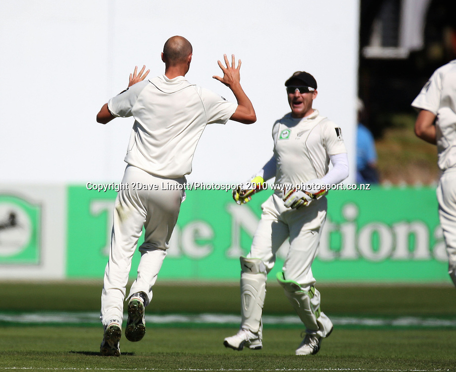 NZ bowler Chris Martin celebrates dismissing Michael Hussey for 4 with keeper Brendon McCullum.<br /> 1st cricket test match - New Zealand Black Caps v Australia, day one at the Basin Reserve, Wellington.Friday, 19 March 2010. Photo: Dave Lintott/PHOTOSPORT