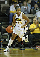December 22 2010: Iowa guard Kachine Alexander (21) brings a rebound down court during the first half of an NCAA college basketball game at Carver-Hawkeye Arena in Iowa City, Iowa on December 22, 2010. Iowa defeated Northern Iowa 75-64.