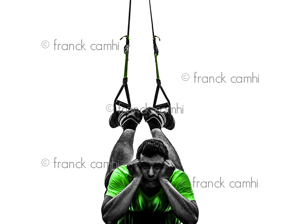one  man exercising suspension training trx tired pouting on white background