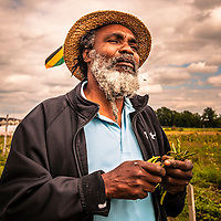"Desmond ""Jah B"" Bailey,  an urban farmer with the Afri-Can FoodBasket Ujamaa Farm program at McVean Farm for the past 7 years. His farm is called Organic Vibes."