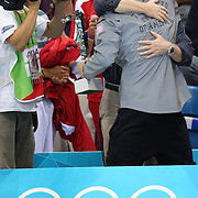 USA swimmer Michael Phelps hugs his coach Bob Bowman after his special achievement award presentation at the Aquatic Centre at Olympic Park, Stratford during the London 2012 Olympic games, London Olympics. London, UK. 4th August 2012. Photo Tim Clayton
