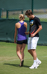 LONDON, ENGLAND - Saturday, July 3rd, 2010: Tomas Berdych (CZE) gives his girlfriend a pinch as he practices ahead of his Men's Singles Final on day twelve of the Wimbledon Lawn Tennis Championships at the All England Lawn Tennis and Croquet Club. (Pic by David Rawcliffe/Propaganda)