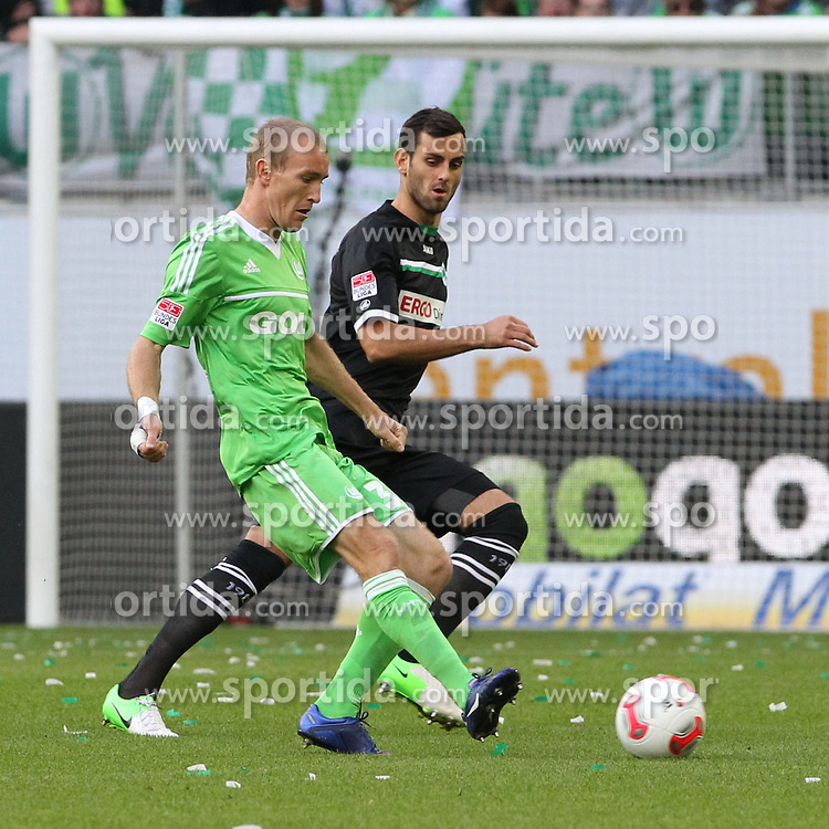22.09.2012, Volkswagen Arena, Wolfsburg, GER, 1. FBL, VfL Wolfsburg vs SpVgg Greuther Fuerth, 4. Runde, im Bild Thomas Kahlenberg (VfL Wolfsburg, li.), Mergim Mavraj (Greuther Fuerth, Nr. 5), -Aktion, Action, // during the German Bundesliga 4th round match between VfL Wolfsburg and SpVgg Greuther Fuerth at the Volkswagen Arena, Wolfsburg, Germany on 2012/09/22. EXPA Pictures © 2012, PhotoCredit: EXPA/ Eibner/ Holger Sieglitz..***** ATTENTION - OUT OF GER *****