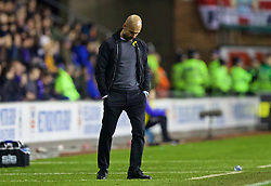 WIGAN, ENGLAND - Monday, February 19, 2018: Manchester City's manager Pep Guardiola looks dejected as his side lose 1-0 during the FA Cup 5th Round match between Wigan Athletic FC and Manchester City FC at the DW Stadium. (Pic by David Rawcliffe/Propaganda)