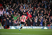 Brentford midfielder, Sam Saunders (7) wheeling away after scoring 1-0 during the Sky Bet Championship match between Brentford and Fulham at Griffin Park, London, England on 30 April 2016. Photo by Matthew Redman.