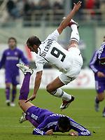 Cagliari 09-01-2005<br /> Campionato  Serie A Tim 2004-2005<br /> Fiorentina Lazio<br /> nella  foto Di Canio, Savini, Obodo<br /> Foto Snapshot / Graffiti