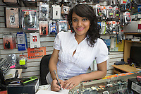 Portrait of young woman working in mobile phone shop