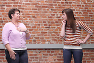 Molly Guyer-Reed of Oakwood (left) and Kathy Roll of Dayton during a Lofty Aspirations improv class at The Livery in the Oregon Arts District in Dayton, Wednesday, February 15, 2012.