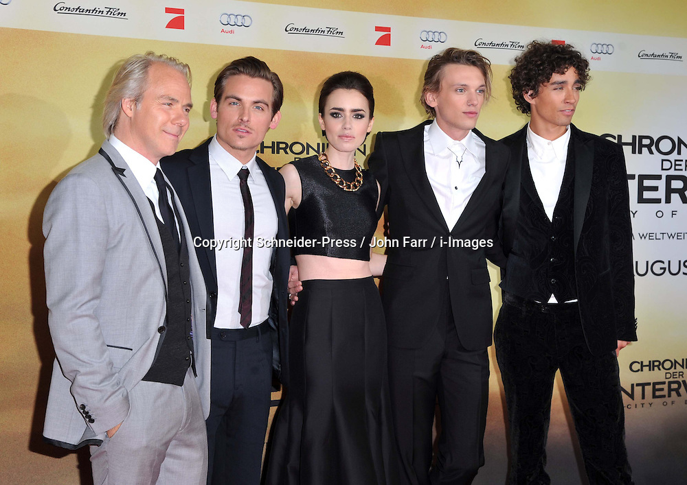 (L-R) Director Harald Zwart, Kevin Zegers, Lily Collins, Jamie Campbell Bower, Robert Sheehan arrive for the 'The Mortal Instruments: City of Bones' Germany premiere at Sony Centre on Tuesday August 20, 2013 in Berlin, Germany. Photo by Schneider-Press / John Farr / i-Images. <br /> UK & USA ONLY