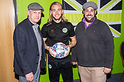 Matchball sponsors Grundon with Forest Green Rovers Joseph Mills(23) during the EFL Sky Bet League 2 match between Forest Green Rovers and Cambridge United at the New Lawn, Forest Green, United Kingdom on 22 April 2019.