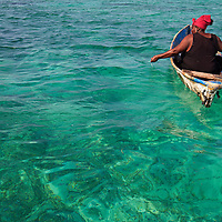 Woman fishing, Garifuna community of Punta Gorda, Roatan Island, Bay Islands, Honduras, April