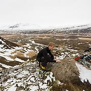 Róbert Halldórsson bolting an anchor at Flögugil, Breiðdalur, East Iceland.