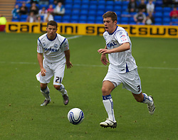 BIRKENHEAD, ENGLAND - Saturday, October 2, 2010: Tranmere Rovers' Aaron Cresswell and Dale Jennings in action during the Football League One match against Brighton & Hove Albion at Prenton Park. (Photo by Vegard Grott/Propaganda)